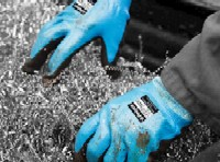 Coated cut protection gloves: Grip It® Oil Therm C5 Knitted nylon cut resistant liner with a dual nitrile coating and fleecy liner
